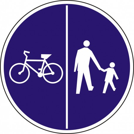 Pedestrians on the right side of the road and bicycles on the left