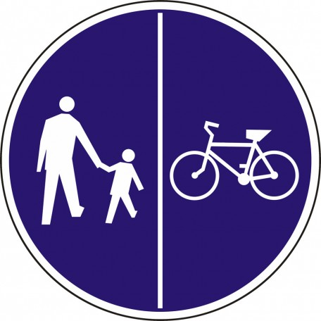 Pedestrians on the left side of the road and bicycles on the right